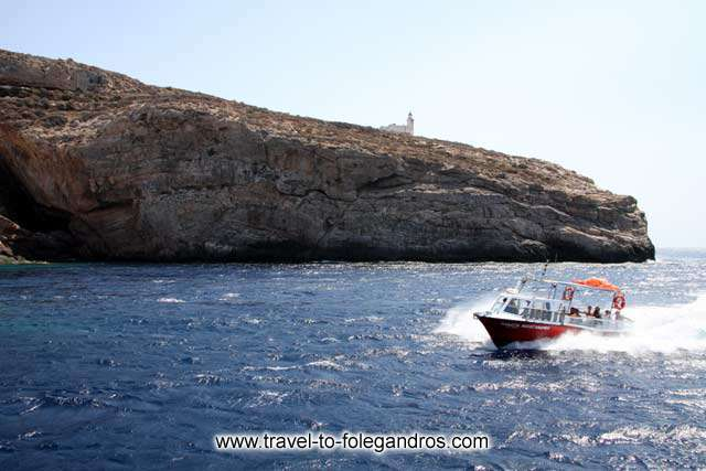 Aspropounta Lighthouse - Small speed boat passing under Aspropounta Lighthouse
