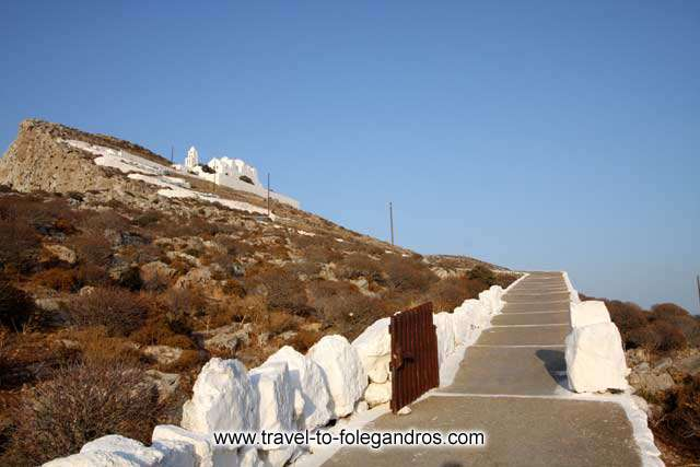 View of Panagia monastery from the pathway on the way up. The church of Virgin Mary dominates the cliff above Chora. FOLEGANDROS PHOTO GALLERY - Panagia by Ioannis Matrozos