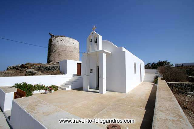 A small church and a windmill at Ano Meria FOLEGANDROS PHOTO GALLERY - Church and windmill by Ioannis Matrozos