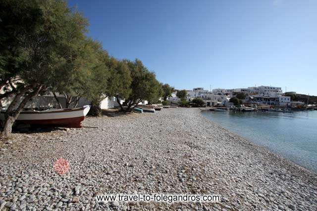 Chochlidia beach - View of Chochlidia, the beach of Karavostassis with the pine trees and the fishing boats below them