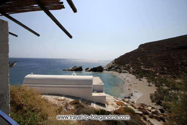 View of Agios Nikolaos church and the beautiful secluded beach from the small cafe restaurant on the south part of the beach FOLEGANDROS PHOTO GALLERY - Agios Nikolaos by Ioannis Matrozos
