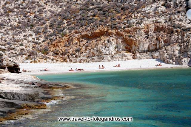 Few tourists enjoying the beauty of Livadaki beach after an hours walk FOLEGANDROS PHOTO GALLERY - Livadaki beach by Ioannis Matrozos