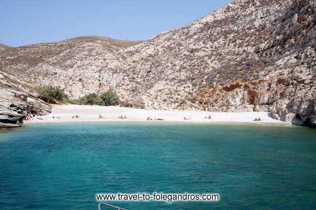 Livadaki beach - Some 30 meters from the beach there are several pine trees to rest under their shadow