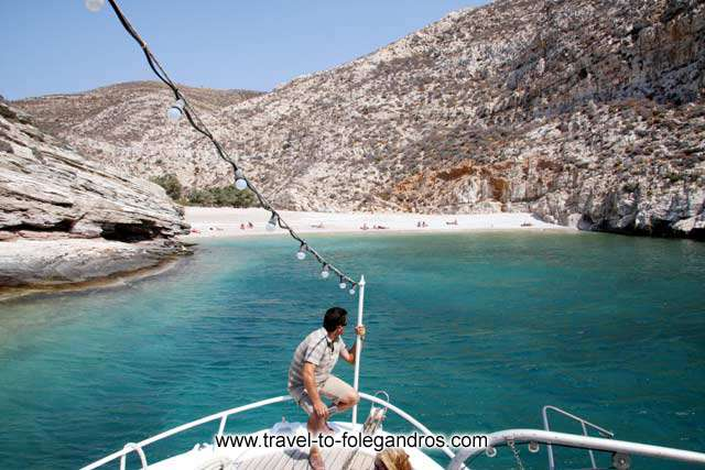The small tour boat arrives at Livadaki FOLEGANDROS PHOTO GALLERY - Livadaki beach by Ioannis Matrozos